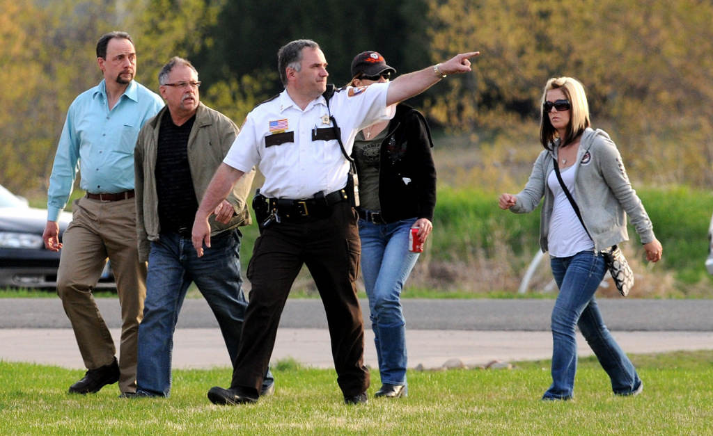. Danielle Jelinek\'s father, Ed Jelinek, second from left, watches as Chisago County Sheriff Rick Duncan, center, point to the swamp where a body believed to be that of Danielle Jelinek was found Friday May 10, 2013 in Chisago Township. (Pioneer Press: Jean Pieri)