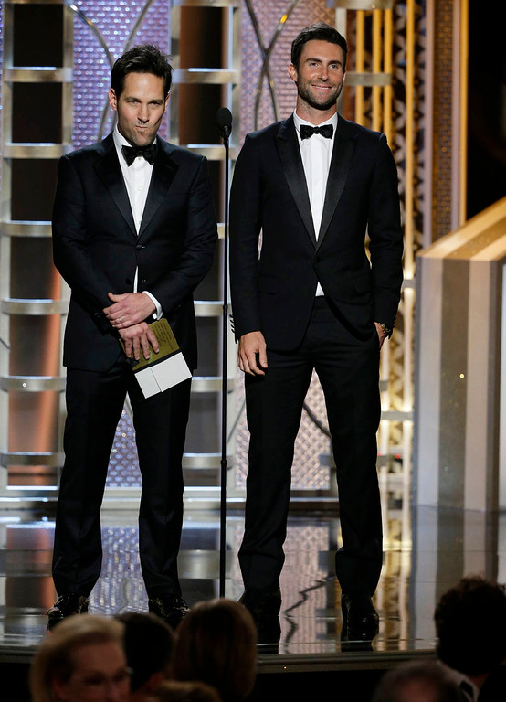 . In this image released by NBC, Paul Rudd, left, and Adam Levine present an award at the 72nd Annual Golden Globe Awards on Sunday, Jan. 11, 2015, at the Beverly Hilton Hotel in Beverly Hills, Calif. (AP Photo/NBC, Paul Drinkwater)