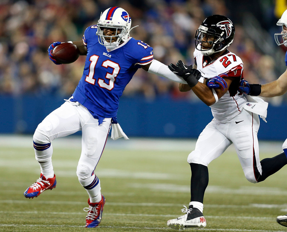 . Buffalo Bills wide receiver Stevie Johnson (13) pushes off Atlanta Falcons cornerback Robert McClain (27) during the first half of an NFL football game on Sunday, Dec. 1, 2013, in Toronto. (AP Photo/Gary Wiepert)