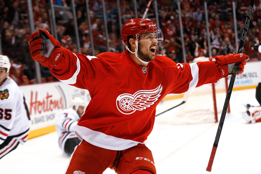 . Detroit Red Wings left wing Tomas Tatar celebrates his goal against the Chicago Blackhawks in the second period of an NHL hockey game in Detroit, Friday, Nov. 14, 2014. (AP Photo/Paul Sancya)