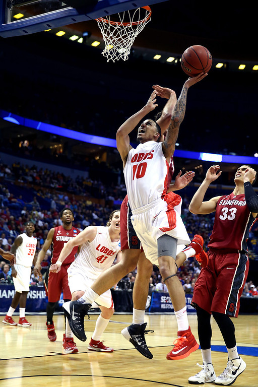 . Kendall Williams #10 of the New Mexico Lobos shoots the ball against Dwight Powell #33 of the Stanford Cardinal during the second round of the 2014 NCAA Men\'s Basketball Tournament at Scottrade Center on March 21, 2014 in St Louis, Missouri.  (Photo by Andy Lyons/Getty Images)