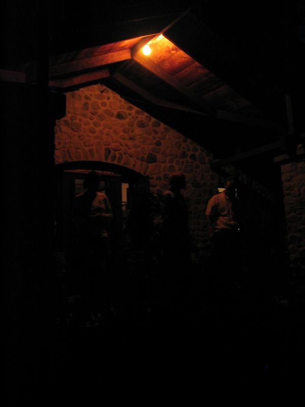 The stone cabin, plus people milling and talking.  (photo by Maggie)