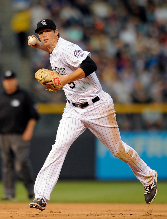 . Colorado Rockies second baseman DJ LeMahieu makes the throw to first base for the out on Arizona Diamondbacks\' Martin Prado in the fifth inning of a baseball game Thursday, June 5, 2014, in Denver. (AP Photo/Chris Schneider)