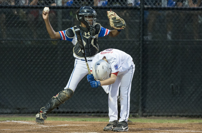 08/09/19  Wesley Bunnell   Staff  New Jersey defeated Washington, DC on Friday August 9, 2019 in a Little League Baseball Eastern Regional Tournament game with New Jersey heading to the final on Saturday to face New York.  New Jersey catcher Joel Sanchez (13) throws down to third base as DC's Jackson Loomis (9) reacts to striking out.