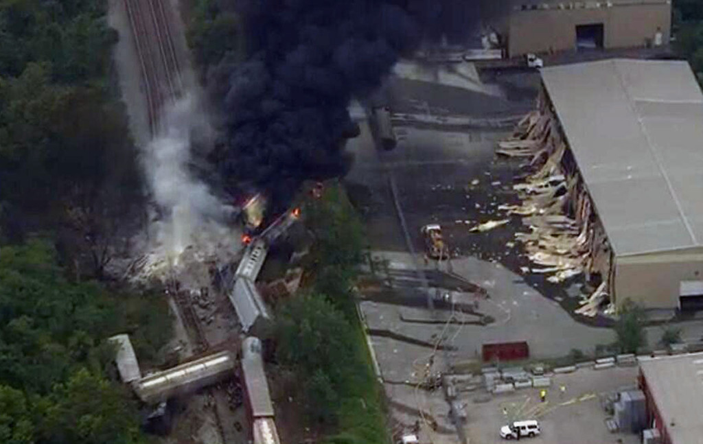 . This image provided by WBAL-TV, shows a train derailment outside Baltimore on Tuesday, May, 28, 2013. A fire spokeswoman says the train derailed about 2 p.m. Tuesday in White Marsh, Md. (AP Photo/WBAL-TV)