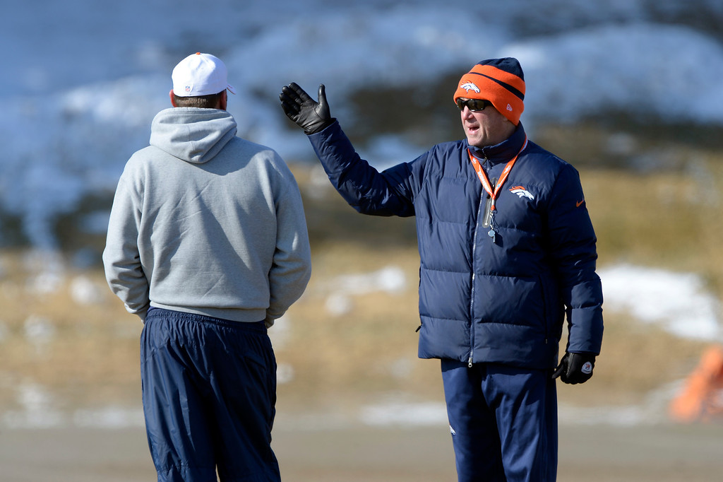 . Denver Broncos head coach John Fox (R) talks with offensive coordinator Adam Gase during practice January 23, 2014 at Dove Valley. (Photo by John Leyba/The Denver Post)