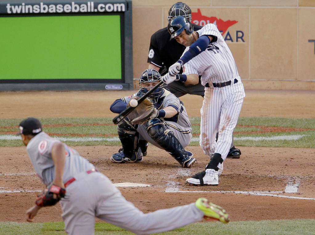 . American League shortstop Derek Jeter, of the New York Yankees, singles during the third inning of the MLB All-Star baseball game, Tuesday, July 15, 2014, in Minneapolis. (AP Photo/Paul Sancya)