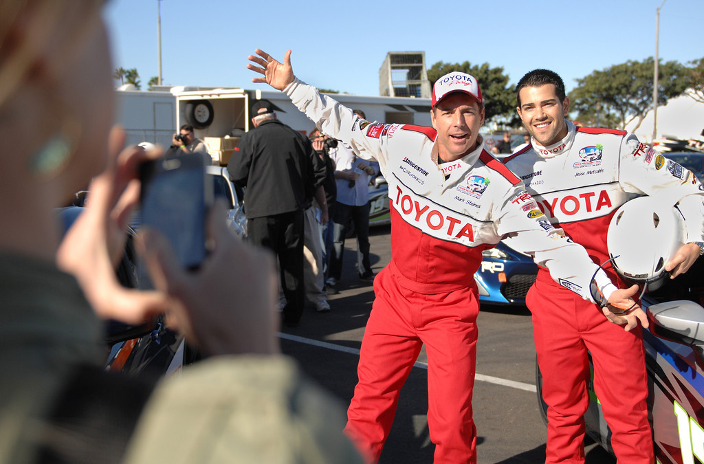 . 4/9/13 - Mark Steines and Jesse Metcalfe pose for a photo during media day for the 39th Annual Toyota Grand Prix of Long Beach. The celebrity/pro races spent the day practicing on the track, joking with their racing partners and giving interviews. Photo by Brittany Murray / Staff Photographer