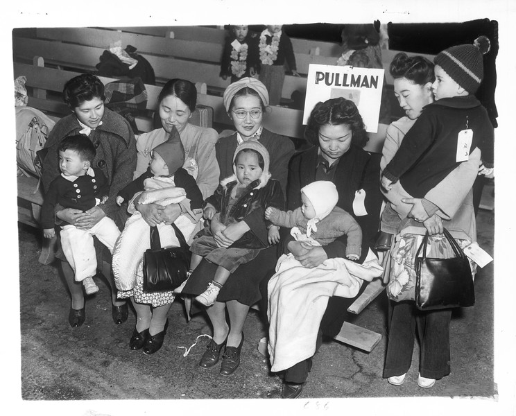"""""""Waiting to board a pullman"""" -- caption on photograph"""