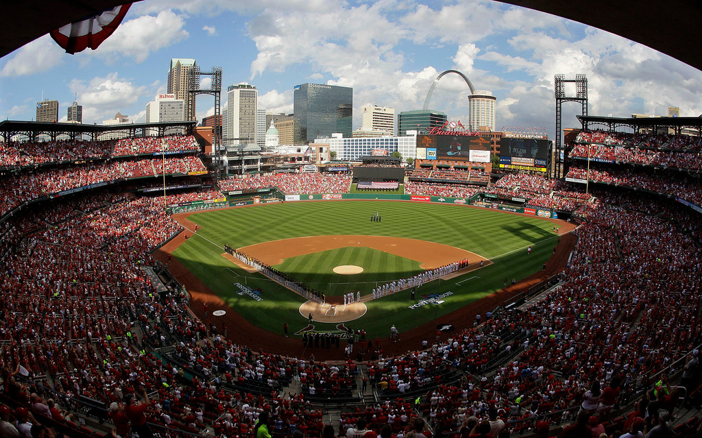 . The St. Louis Cardinals and the Pittsburgh Pirates are introduced before the start of Game 1 of baseball\'s National League division series on Thursday, Oct. 3, 2013, in St. Louis. (AP Photo/Mark Humphrey)