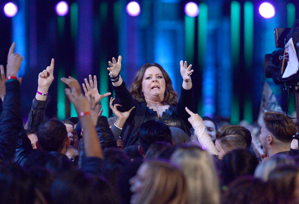 . Melissa McCarthy crowd surfs toward the stage before accepting the comedic genius award at the MTV Movie Awards at Warner Bros. Studio on Saturday, April 9, 2016, in Burbank, Calif. (Kevork Djansezian/Pool Photo via AP)