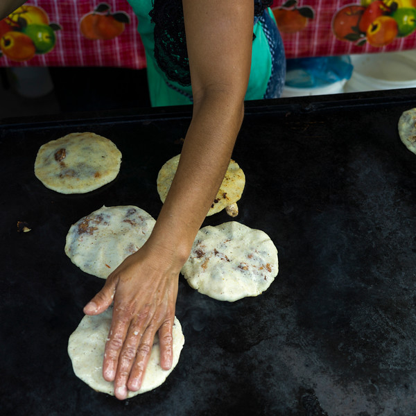 Person baking Pupusas, a traditional flatbread, San Ignacio, Belize