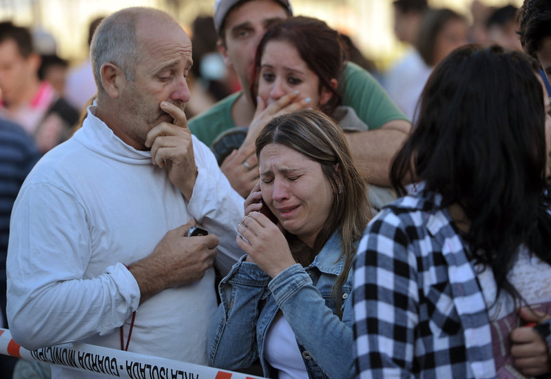 . Relatives of victims cry after a fire at a nightclub in Santa Maria, 550 Km from Porto Alegre, southern Brazil on January 27, 2012. More than 150 people died early Sunday when a fire tore through a nightclub in the southern Brazilian city of Santa Maria during a boisterous student party, police said. Brazilian President Dilma Rousseff interrupted her visit to Chile. LAURO ALVES/AFP/Getty Images