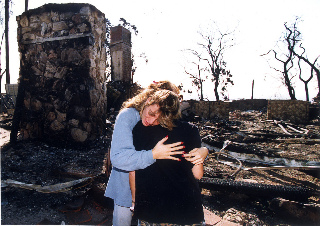 . Sylvia Kavalgian hugs her mother, Alice Kavalgian, in an emotional moment at the site of their devastated home on Big Rock Drive.  (11/4/93)   Los Angeles Daily News file photo