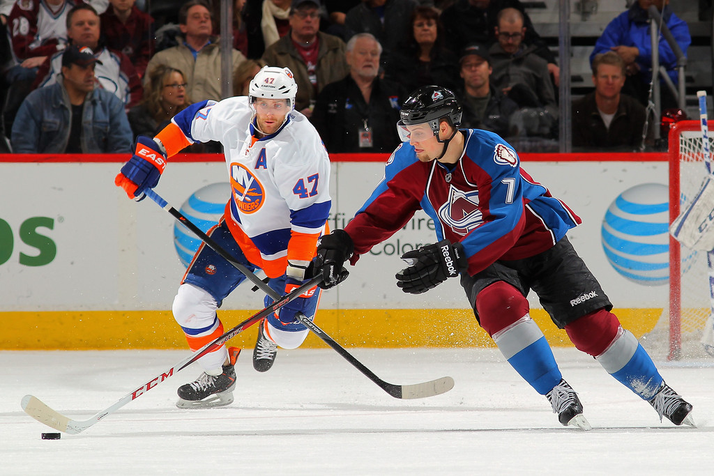 . DENVER, CO - JANUARY 10:  John Mitchell #7 of the Colorado Avalanche controls the puck as Andrew MacDonald #47 of the New York Islanders follows the play at Pepsi Center on January 10, 2014 in Denver, Colorado.  (Photo by Doug Pensinger/Getty Images)