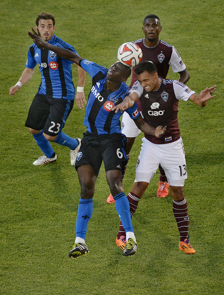 . Montreal defender Hassoun Camara (6) competed with Colorado forward Kamani Hill (13) for a ball in the first half. The Colorado Rapids hosted the Montreal Impact Saturday night, May 24, 2014. (Photo by Karl Gehring/The Denver Post)