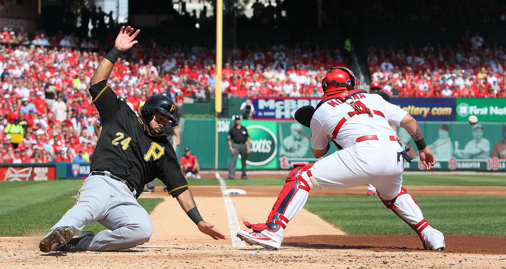 . Pittsburgh Pirates\' Pedro Alvarez scores past St. Louis Cardinals catcher Yadier Molina on a single by Gerrit Cole in the second inning during Game 2 of the National League division series, Friday, Oct. 4, 2013, in St. Louis. The Pirates won 7-1. (AP Photo/St. Louis Post-Dispatch, Chris Lee) EDWARDSVILLE OUT  ALTON OUT