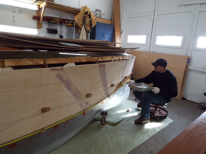 Another view of the epoxy being applied to the starboard hull side.