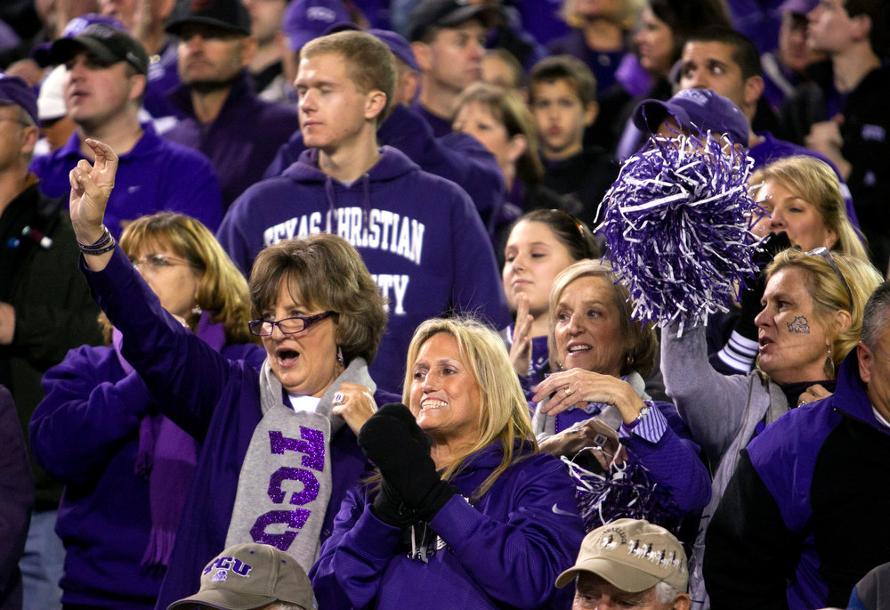 Description of . TCU fans cheers before the start of the Buffalo Wild Wings Bowl NCAA college football game between TCU and Michigan State, Saturday, Dec. 29, 2012, in Tempe, Ariz. (AP Photo/The Arizona Republic, David Wallace)