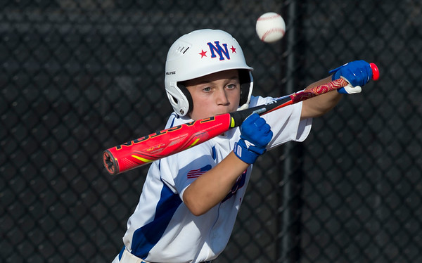 08/05/19 Wesley Bunnell | Staff New York Haverstraw Little League defeated Delewar's Neward National Little League Monday evening at Breen Field in Bristol. Joey Papili (5) with a bunt attempt.