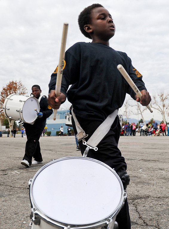 ". A drummer performs during the 44th annual Black History Parade at the National Orange show in San Bernardino on Saturday, Feb. 2, 2013. Hosted by the Southern California Black chamber of Commerce, this year\'s parade theme marked tribute to the 50th anniversary of Dr. Martin Luther King Jr. speech, ""I Have a Dream.\"" (Staff file photo/The Sun)"