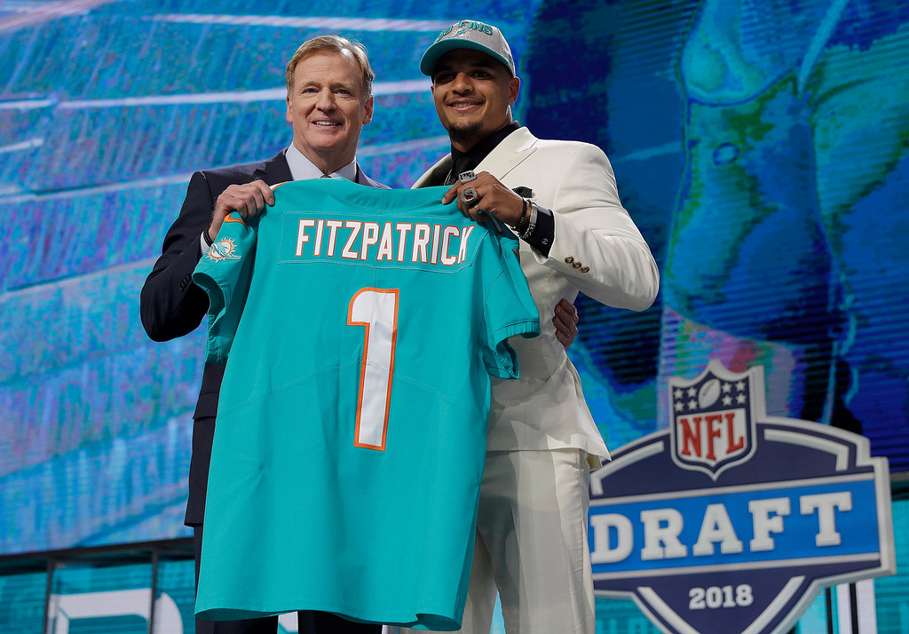 . Commissioner Roger Goodell, left, poses with Alabama\'s Minkah Fitzpatrick after Fitzpatrick was selected by the Miami Dolphins during the first round of the NFL football draft, Thursday, April 26, 2018, in Arlington, Texas. (AP Photo/David J. Phillip)