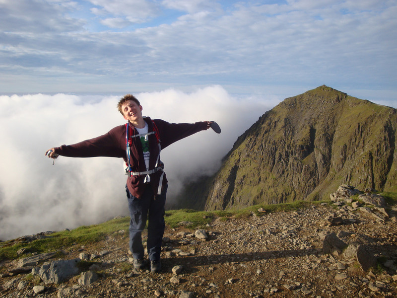 Andrew T strikes his signature pose atop Carnedd Ugain summit