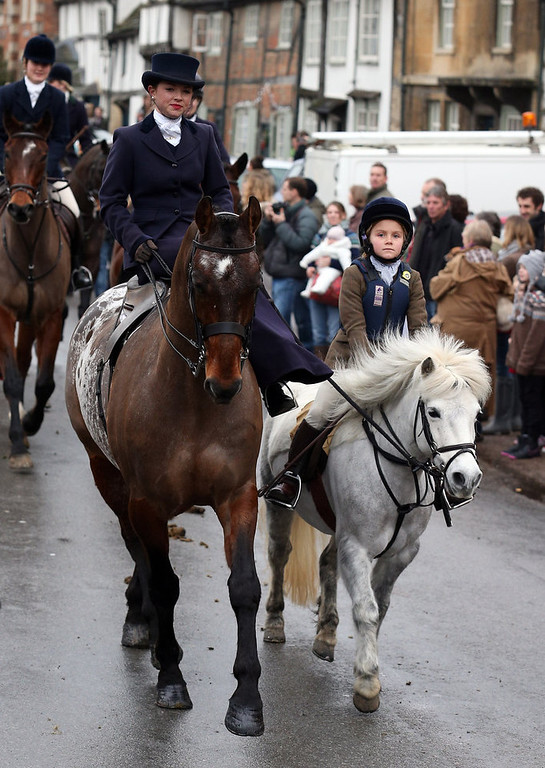 . A young rider with the Avon Vale Hunt, follows the hounds as they ride out for their traditional Boxing Day hunt, on December 26, 2012 in Lacock, England. As hundreds of hunts met today, Environment Secretary Owen Paterson claimed that moves to repeal the ban on hunting with dogs in England and Wales may not happen in 2013, although he insisted it was still the government\'s intention to give MPs a free vote on lifting the ban.  (Photo by Matt Cardy/Getty Images)