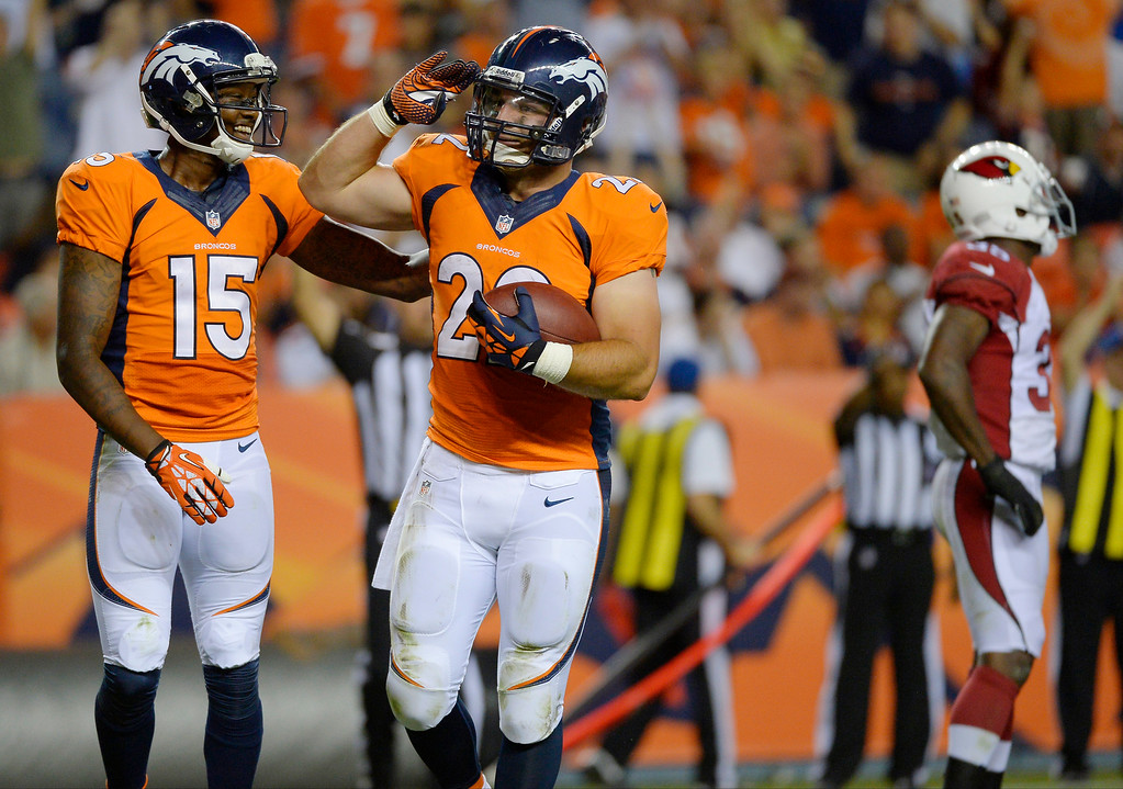 . Jacob Hester (22) of the Denver Broncos celebrates a touchdown against the Arizona Cardinals with teammate Tavarres King (15) during the last pre-season game of the season at Sports Authority Field at Mile High. August 29, 2013 Denver, Colorado. (Photo By Joe Amon/The Denver Post)