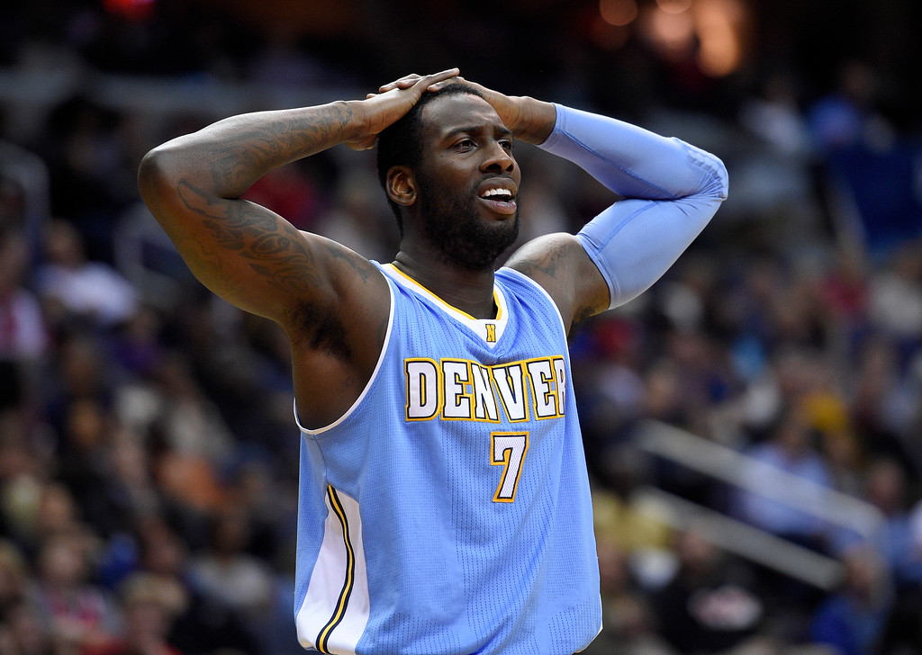 . Denver Nuggets center J.J. Hickson (7) reacts after he was called for a foul during the second half of an NBA basketball game against the Washington Wizards, Friday, Dec. 5, 2014, in Washington. (AP Photo/Nick Wass)