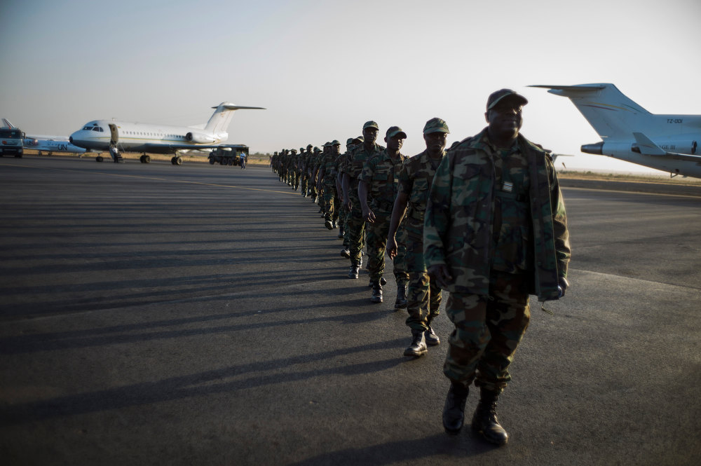Description of . Togolese soldiers arrive at the airport on January 17, 2013, in Bamako. Forty Togolese soldiers arrived in Mali today, the first of those pledged by African nations to back a French-led offensive against Islamist rebels. West African troops have promised more than 3,000 soldiers to back Operation Serval, launched on January 11. FRED DUFOUR/AFP/Getty Images
