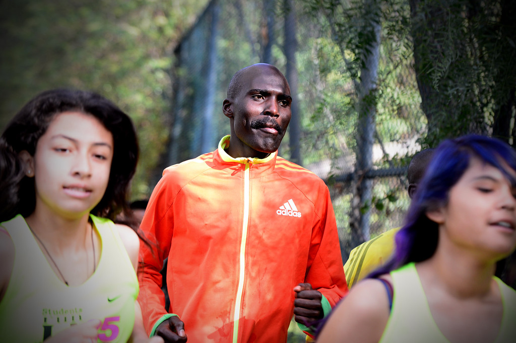 . Elite marathon runner Laban Moiben, who is the 2008 LA Marathon champion, joins students, of the Students Run LA program, for a short run as elite athletes train at Griffith Park in Los Angeles Friday, March 7, 2014 for the LA Marathon. The students will also be running Sunday\'s marathon. (Photo by Sarah Reingewirtz/Pasadena Star-News)