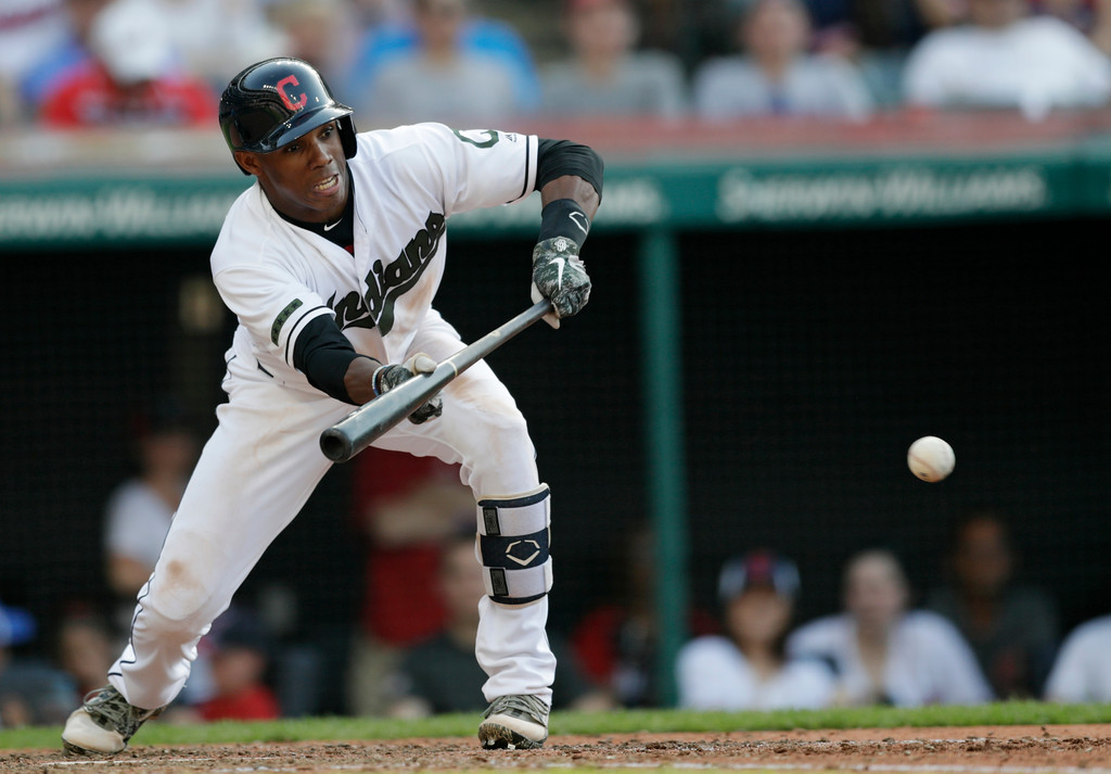 . Cleveland Indians\' Greg Allen hits a sacrifice bunt in the sixth inning of a baseball game against the Chicago White Sox, Monday, May 28, 2018, in Cleveland. (AP Photo/Tony Dejak)