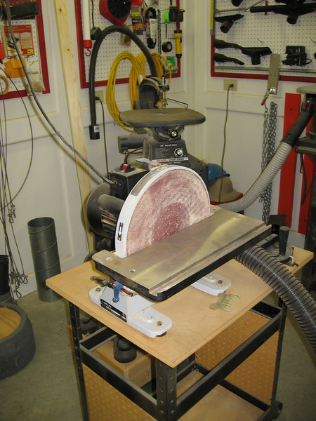 Disk sander, with fine detail reciprocating saw in the background.