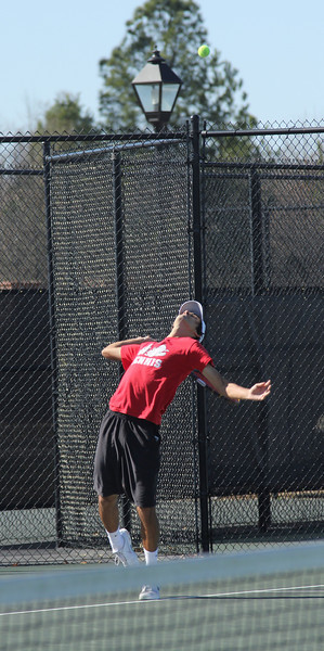Korhan Ates serves against his opponent on February 19th, 2011.