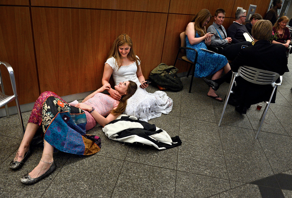 """. At 3:30 a.m., Sarah Mutter, left, and Isabel Aguirre wait to apply for their civil-union license outside the Clerk and Recorder\'s office in Denver. \""""Other people get to say fiancee and wife, and all we can say is girlfriend or partner,\"""" said Sarah, who made her commitment a government affair Wednesday morning with her partner of four years. Isabel added: \""""This is a big step � for us to be taken as legally accepted.\"""""""