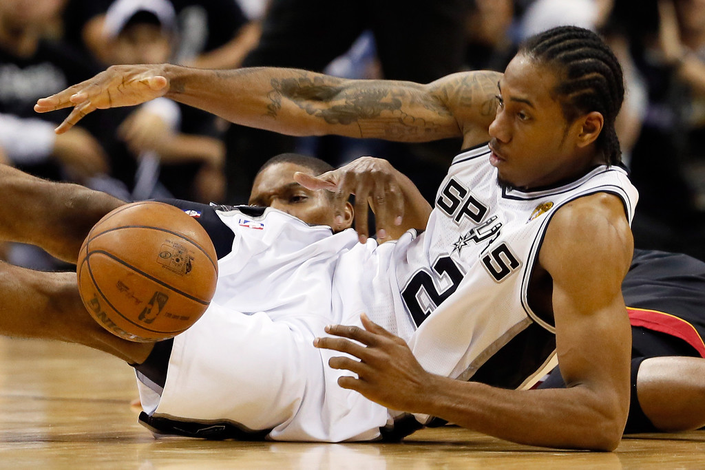 . Kawhi Leonard #2 of the San Antonio Spurs and Chris Bosh #1 of the Miami Heat go after a loose ball in the first half during Game Five of the 2013 NBA Finals at the AT&T Center on June 16, 2013 in San Antonio, Texas. (Photo by Kevin C. Cox/Getty Images)