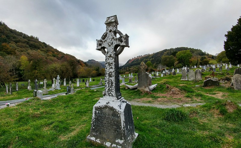 old cementary with large Celtic cross headstone