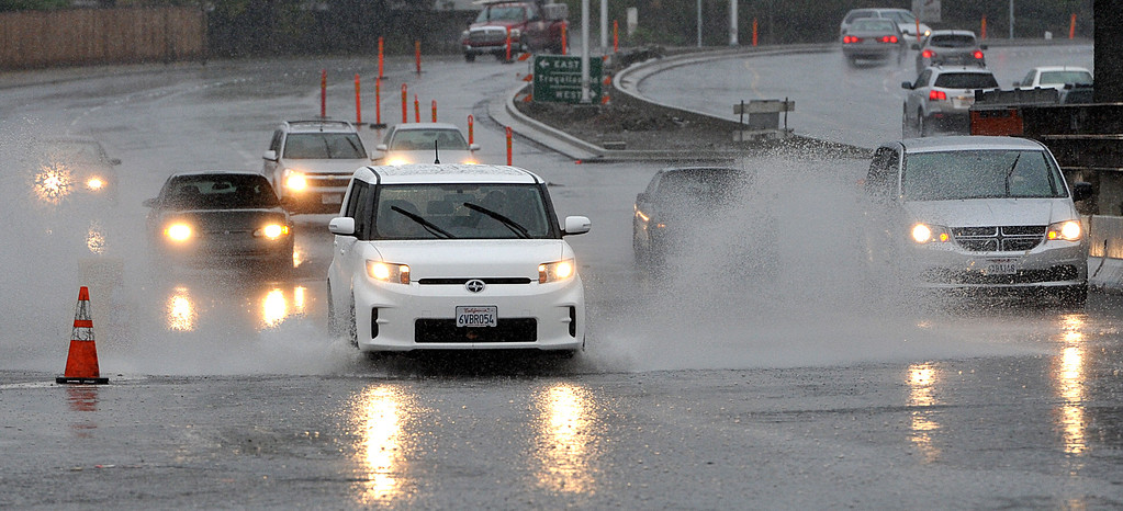 . Cars drive through a flooded area of A Street in Antioch, as heavy rains and winds cause problems in Antioch, Calif., on Thursday, Dec. 11, 2014.  (Dan Rosenstrauch/Bay Area News Group)