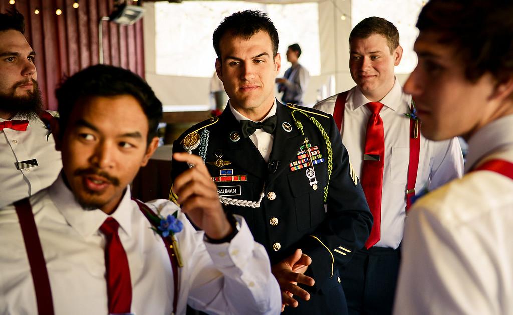 . Cody Bauman is surrounded by his groomsmen before his wedding April 11, 2014. (Pioneer Press: Ben Garvin)