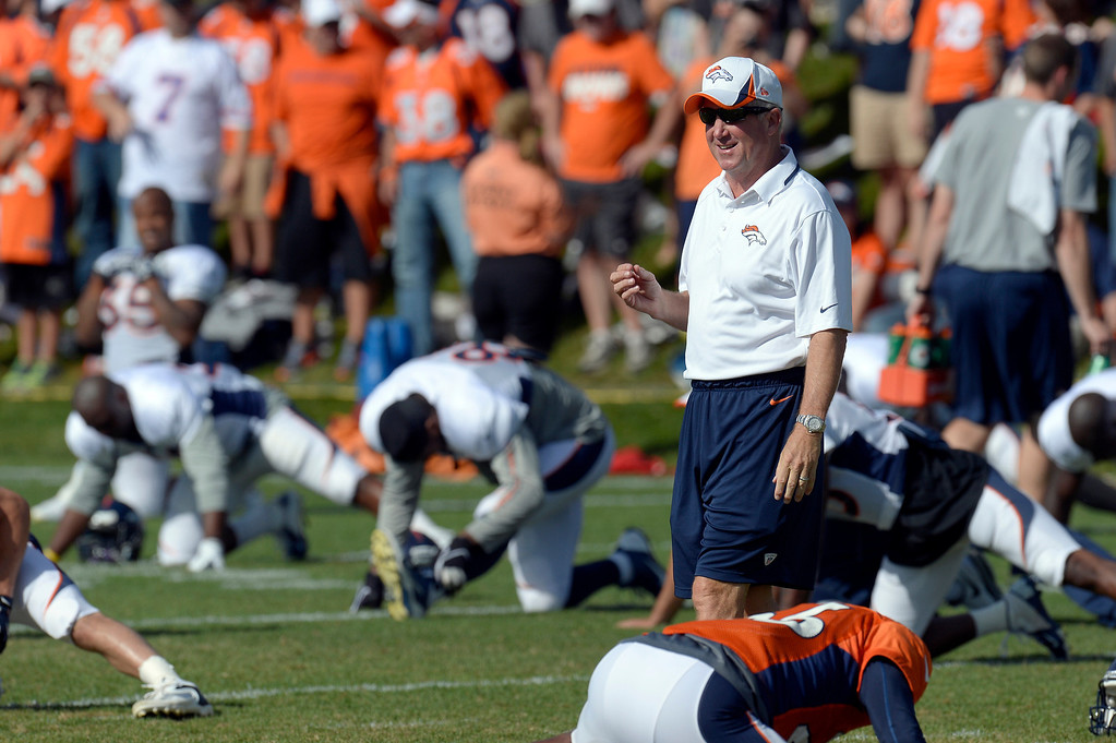 . Denver Broncos head coach John Fox smiles during stretching before practice during training camp August 6, 2013 at Dove Valley. (Photo By John Leyba/The Denver Post)