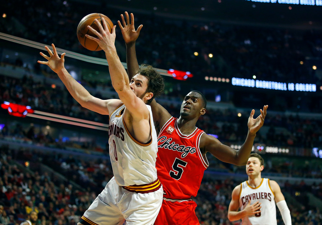 . Cleveland Cavaliers forward Kevin Love (0) grabs a rebound from Chicago Bulls forward Bobby Portis (5) during the second half of an NBA basketball game in Chicago on Saturday, April 9, 2016. (AP Photo/Jeff Haynes)