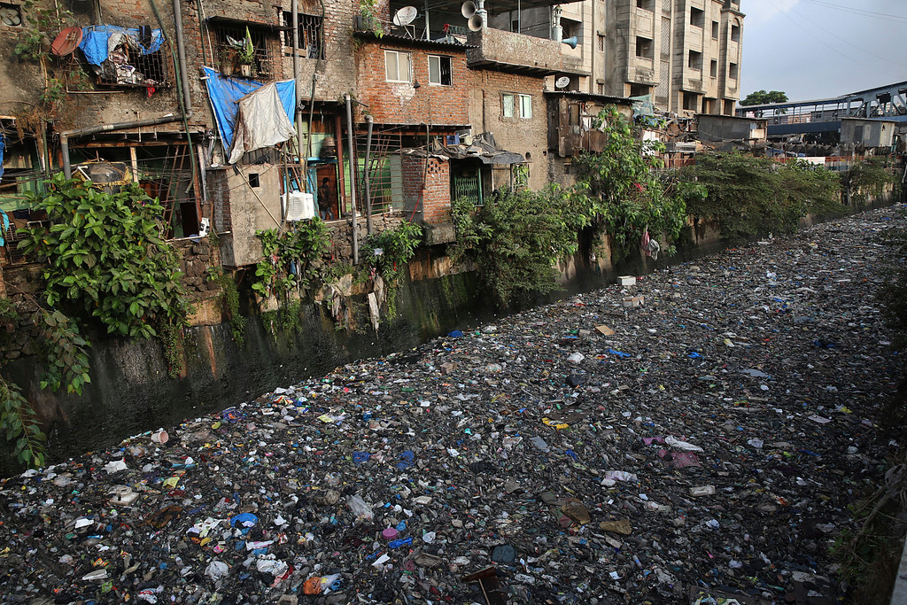 ". Garbage chokes a polluted canal in Mumbai, India, Monday, June 4, 2018. The theme for this year\'s World Environment Day, marked on June 5, is ""Beat Plastic Pollution.\"" (AP Photo/Rafiq Maqbool)"