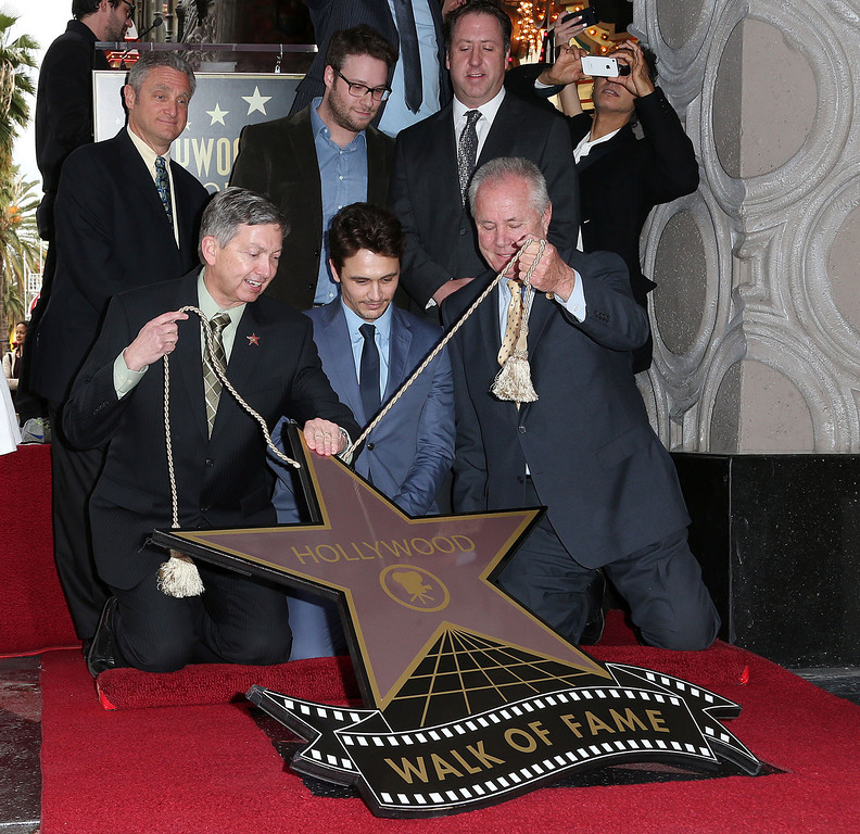 . L-R) Leron Gubler, President/CEO, Emcee: Hollywood Chamber of Commerce, actor James Franco, Tom LaBonge and guest attend the installation ceremony  honoring actor James Franco on The Hollywood Walk Of Fame on March 7, 2013 in Hollywood, California.  (Photo by Frederick M. Brown/Getty Images)