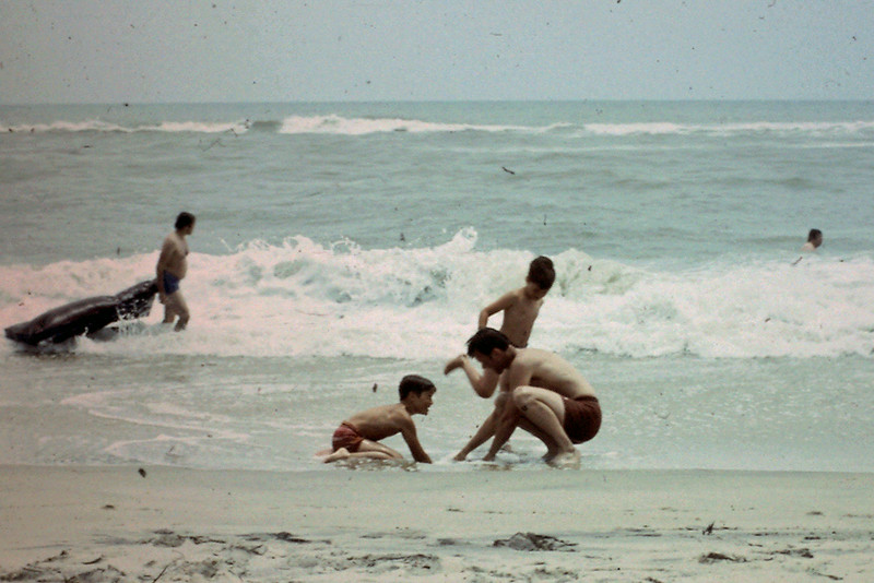 Dwaine, Randy, Jeff play in surf at Outer Banks, NC beach