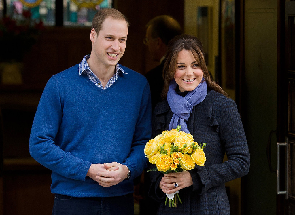 . Britain\'s Prince William, the Duke of Cambridge, (L) poses for pictures with his wife Catherine, Duchess of Cambridge, as they leave the King Edward VII hospital in central London, on December 6, 2012. Prince William\'s pregnant wife Catherine left a London hospital on Thursday, four days after she was admitted for treatment for acute morning sickness.  LEON NEAL/AFP/Getty Images