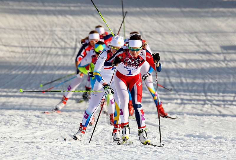 . Maiken Caspersen Falla of Norway leads the pack in Finals of the Ladies\' Sprint Free during day four of the Sochi 2014 Winter Olympics at Laura Cross-country Ski & Biathlon Center on February 11, 2014 in Sochi, Russia.  (Photo by Doug Pensinger/Getty Images)