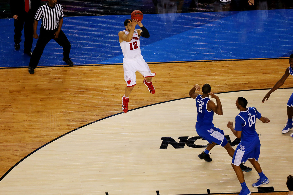 . ARLINGTON, TX - APRIL 05: Traevon Jackson #12 of the Wisconsin Badgers misses a shot at the buzzer against the Kentucky Wildcats during the NCAA Men\'s Final Four Semifinal at AT&T Stadium on April 5, 2014 in Arlington, Texas. The Kentucky Wildcats defeated the Wisconsin Badgers 74-73. (Photo by Ronald Martinez/Getty Images)