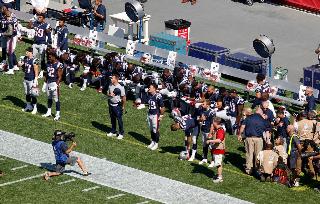 . Several New England Patriots players kneel during the national anthem before an NFL football game against the Houston Texans, Sunday, Sept. 24, 2017, in Foxborough, Mass. (AP Photo/Stew Milne)