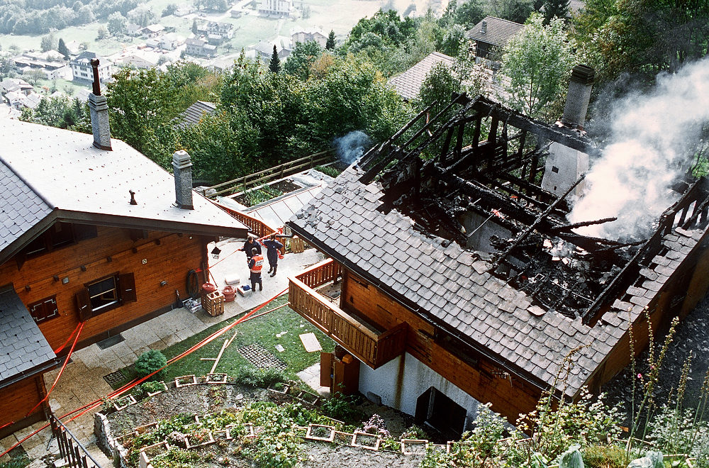 Description of . A picture taken on October 5, 1994 shows a burning house in Cheiry village, in Switzerland, where 23 bodies were found. On the 4th and the 5th of October, 25 and 23 people were found dead, respectively, in Salvan and Cheiry villages in a mass suicide connected to the Order of the Solar Temple. It is believed the group thought the end of the world would come in the mid-1990s and they had to achieve a higher spiritual plane by taking their lives before then.  EDI ANGELER/AFP/Getty Images